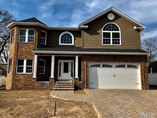 New Construction This Magnificent Brick Front Colonial Feature 3100 Sq Ft. Living Area, Great School District, Hardwood Floors, Eik W/Quartz Counter Tops /Ss Applianes, Great Room W/ Gas Frpl, Fdr, Lr, Master Suite W/Vaulted Ceilings/2 Wic /Fbth, 3 Additional Bedrooms, Laundry Room On Second Floor, Full Basement W/8Ft Ceilings /Outside Entrance, 2 Zone Heating And Cac, 75X100 Lot Size, 2 Car Garage, Great Location!!!