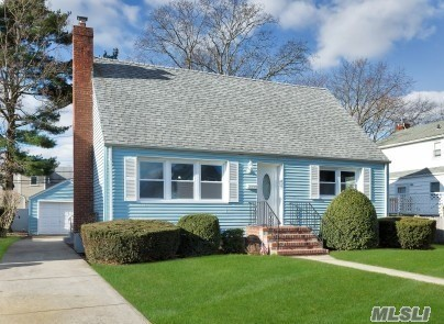 Mint Rear Dormered Cape In Flower Section Of Merrick. Natural Lighting W/Gleaming Hardwood Floors. Hi Hats.  Brand New Kitchen, Quartz Counter Tops, Whirlpool Ss Applcs & Whirlpool Washer/Dryer. Sun Drenched Den W/Wood Burning Fireplace, Nice Yard, Detached Garage. Fayette Elementary, Merrick Ave Middle (Mams), Calhoun Hs. Most New Windows, Cedar Closet, Gas Cooking, Gas Line In House. 200 Amps, Updated Wiring, 4 Ceiling Fans, 10 Yr Young Roof. Cement Driveway. Master Can Be Up Or Main Level