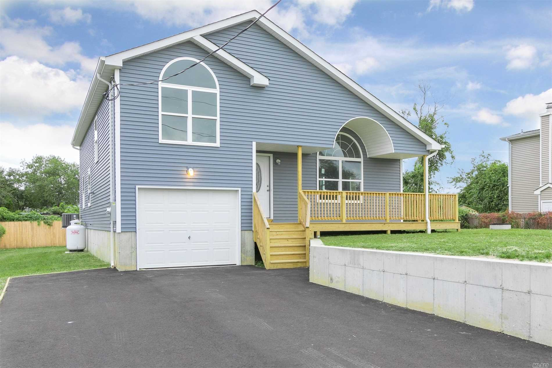 Spectacular Contemporary Style Home- You'll Noice The Wraparound Deck That Leads To The Master Suite. Open Concept Home. Beautiful Loft That Overlooks The Main Floor. Hard Wood Floors, Cac. Many Upgrades In This New Home. Must See.