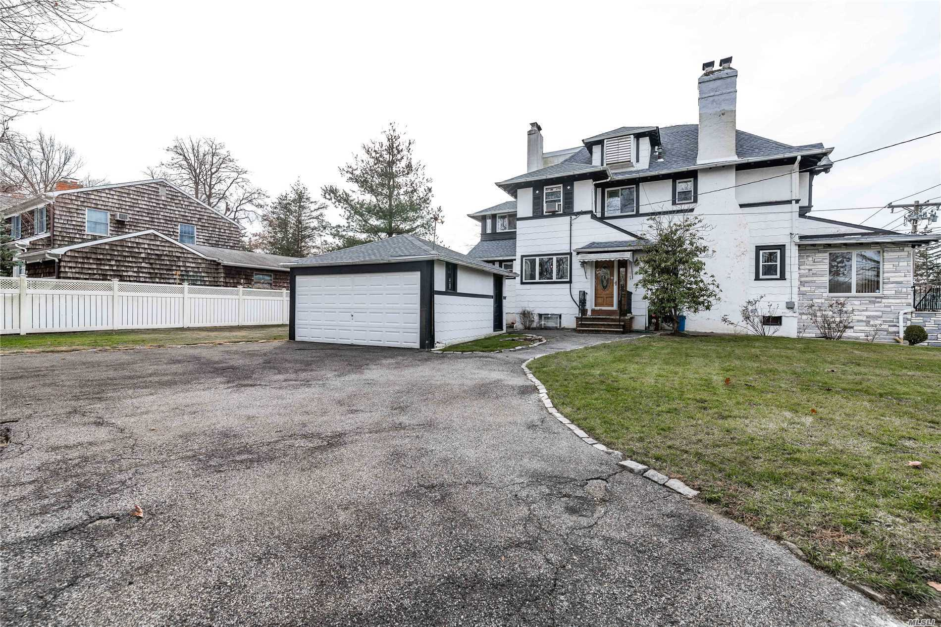 Handsome Tudor-Esque Colonial In Douglaston Neighborhood,  Featuring Large Finished Basement, Master Suite With Dressing Room And A Oversized Guest Suite With Full Bathroom. This Spacious Home Is Nestled On A Large Land 94X100 With Old World Charm And Details Thru-Out!