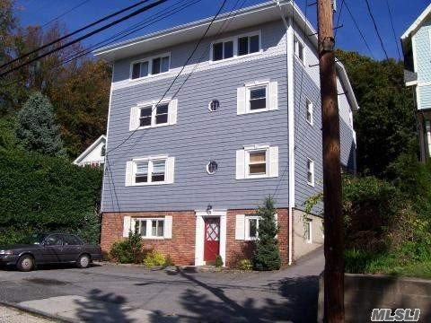 Large Apt With New Carpet, New Kitchen And 1 New Bath. Lr, Den, Eik, Queen Bed With Bath Plus 2nd Bath. Off Street Parking In Rear Of Building, Rent Includes Utilities. Shared Laundry Room. Seasonal Ac Fee Of $270 Per Unit. Walk To Main Street, Park, Dock, Theater And Restaurants. 2Mos Security Rent Includes Utilities. Available Immed.No Pets, No Smoking, Good Credit