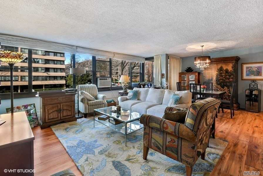 Ready To Move Into. Beautifully Rich Engineered Hardwood Floors Throughout Entire Apartment. Open Concept Kitchen With Breakfast Bar, Pecan Wood Cabinets, Fan/Overhead Lighting And Spanish Tile Flooring. Clean And Updated White-Tiled Bathroom. Washer Or Dryer On Every Floor. No Dogs Allowed. Amenities Include: A Fitness Center, 2 Outdoor Pools, 3 Tennis Courts, Clubhouse And Restaurant.
