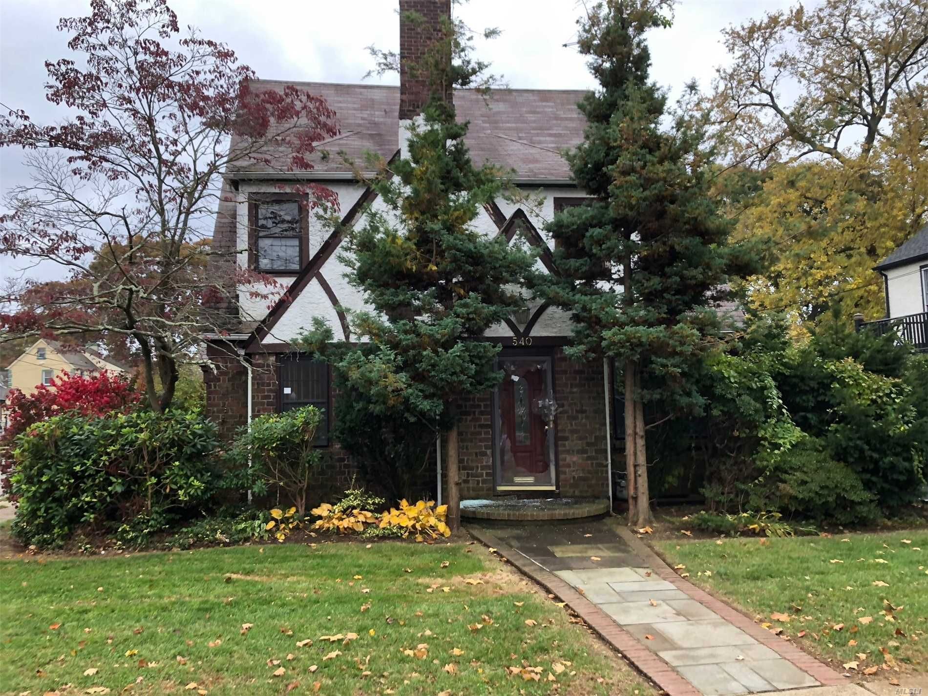 Tudor Style Home. This Home Features 3 Bedrooms, 3 Full Baths, Dining Room, Eat In Kitchen & 2 Car Garage. Centrally Located To All. Don't Miss This Opportunity!