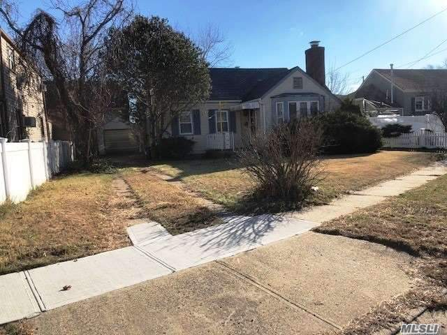Huge One Family Featuring 4 Bedrooms, Large Livingroom, Fireplace, Kitchen With A Nook, Full Bath With An Enclosed Back Porch. Property Has A One Car Garage With A Huge Yard.