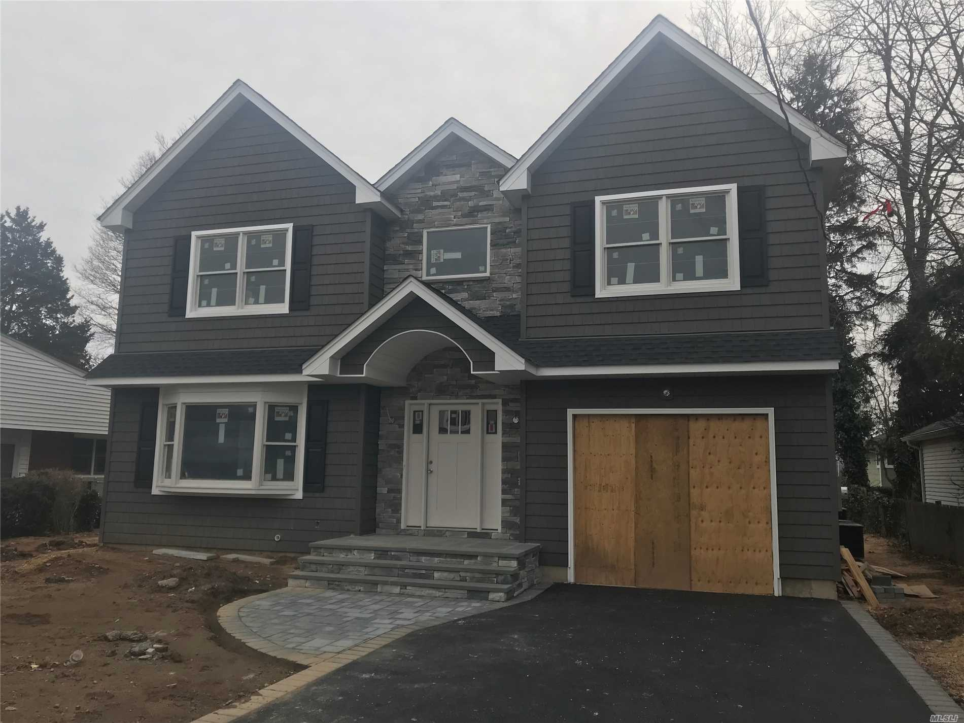 New Construction! 4 Bedroom, 2.5 Bath Colonial Features Granite Eat-In-Kitchen W/White Shaker Cabnets, Formal Dining, Living Room, Den, Laundry Room On 2 Level, Hardwood Floors Thru-Out, Crown Moldings, Fireplace, 2 Zone Cac, Basement With 9 Foot Ceilings And Attached 1 Car Garage.