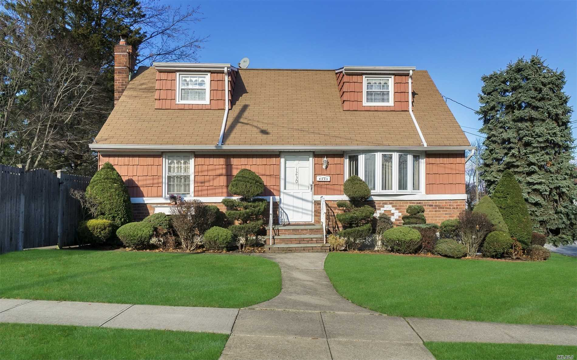 Nice, Clean, Lovingly Maintained Brick Rear Dormered Cape. 4 Bedrooms., 2 Full Baths Finished Basement With Outside Entrance. Granite/ Stainless Kitchen With Dining Area. Great Location. Minutes To Lirr, Shopping, Park & Track! Lots Of Closets. Nicely Landscaped. Fenced Yard