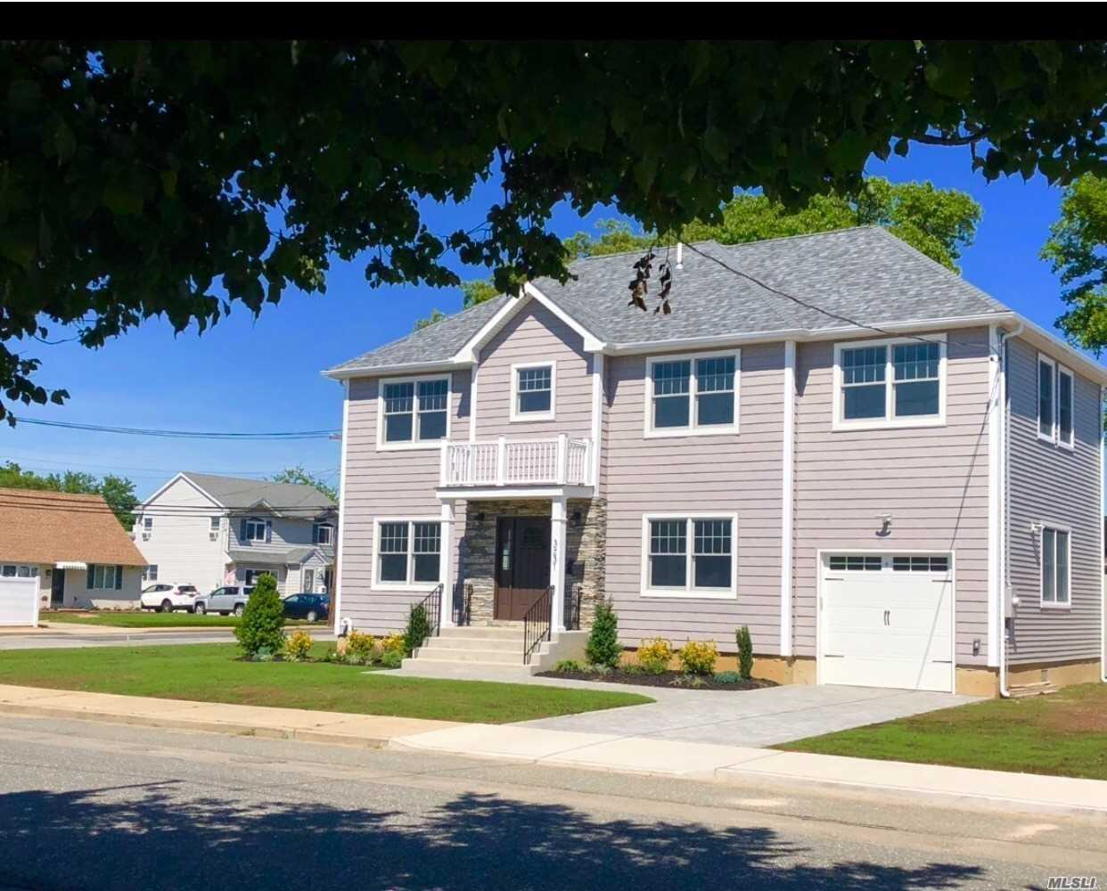 New Beautiful Colonial Offers 4 Lg Bedrooms, 2.5 Baths Beautifully Done, Kitchen W/Granite & Ss Appliances, Fdr, Large Lr, Hw Floors Through Out, Master Suite W/ Walk In Closets & Master Bath, Washer & Dryer On 2nd Floor, 1.5 Car Garage, 2 Zone Central A/C , Gas... Fema Compliant. A Must See!!!