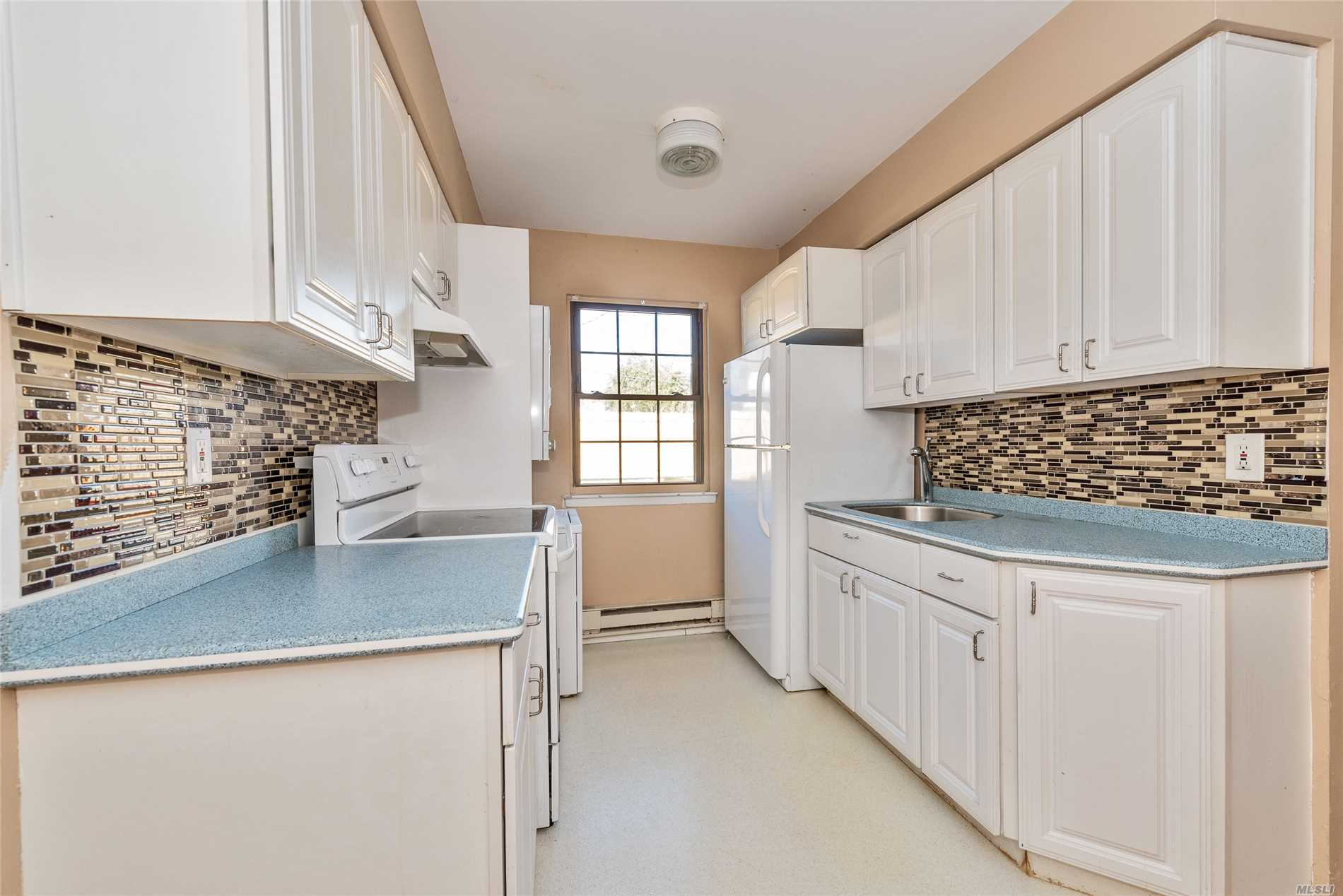 Sale May Be Subject To Terms & Conditions Of An Offering Plan. First Flr Condo W/Lrg Living Rm W/Hw Flrs, Eik W/Dining Area, Stackable Washer/Dryer, Pantry Storage, Upd Bath & Bdrm. Common Charges: $330/Mo Plus $180.85 (5-Yr Capital Improvements Ending 2021) & $134.68 (5-Yr- Loan Ends 2023) So Total Of $645.53. Unit Gets 1 Parking Spot In Front, Ample Guest Parking On Sides. Near Shopping, Lirr, Schools, Houses Of Worship, Library, Restaurants, Highways & Parkways. Why Rent When You Can Own!