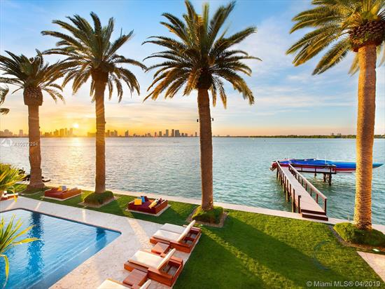 Enrique Iglesias Former Home Villa Jasmine, Sits On The Sw Tip Of Prestigious Gated Community Sunset Island 1. Exotic Waterfront Estate Offers Direct Miami Skyline & Biscayne Bay Views. Impressive Granite Driveway Lined By Majestic Royal Palms, Leading To A Luxurious 7, 622 Sf Home. Main House Has An Interior Courtyard & Fountain, Soaring Arched Windows Which Provides Indoor/Outdoor Florida Lifestyle. Spacious Living Areas, Formal Dining, Large Chef'S Kitchen And Unique Onyx Wet Bar. Guesthouse W/ Rooftop/Jacuzzi And 150' Screen Cinema. Large Backyard W/ Pool, Gazebo & Summer Kitchen. 22, 093 Sf Lot W/ Dock, W/ 150 Ft Of Prime Water-Frontage, 22, 000 Lb Boatlift & 3-Car Garage. A True Luxury Estate Designed To Enjoy The Dramatic Sunsets And Views Of The Ever-Growing Dazzling Miami Skyline.