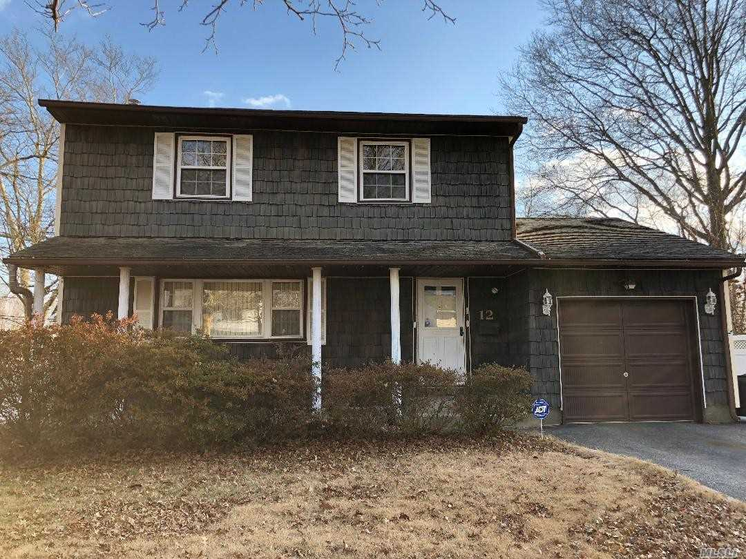3 Br Colonial W/ Possibility Of 4 Br With Proper Permits, Flat Usable Property W/ Large Sized Backyard, Wood Floors Throughout, In The Desirable Commack School District. Formal Dining Room, Eat In Kitchen, Living Room, And Den On The Main Level.