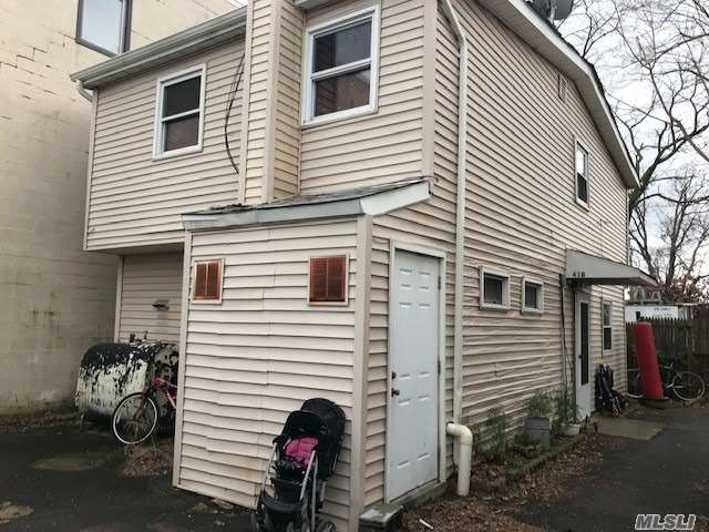 Opportunity For Investors! Mix Use Two Houses On 1 Property. Very Lucrative Rental Amount!. This Property Is Also Zoned For Commercial Use Front Apt. There Are Two Separate Buildings. Parking In Front And On Side. Currently Rented For Six Figures And Has Sep. Meters Front Is Zoned Commercial Good For Business Has Parking As Well.1 House Has Three Apts. W/Ose. Other House Has Five Bdrms.Eik.Din.Area. Two Full Baths. Sep.Heat Sys.And Own Electric. Three Sep. Meters Total.