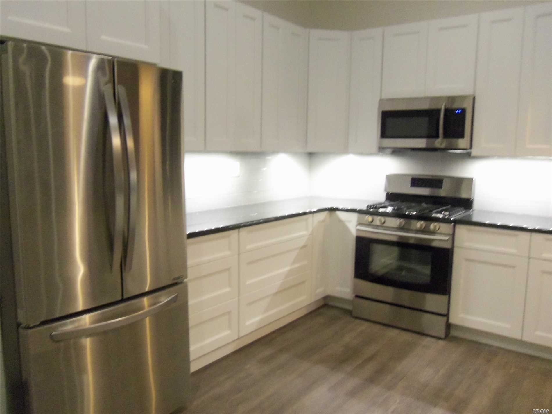 Newly Renovated Luxury One Bedroom Apartment In Elevator Building Across From The L I R R Station. High Ceilings, Exposed Brick And New Kitchen And Bath With Granite Counters. Amenities Include Central Air Conditioning, Own Thermostat And All Appliances Including Dishwasher, Microwave & Washer And Dryer. Large Bedroom And Walk-In Closet! No Pets Or Smoking. Good Credit A Must!