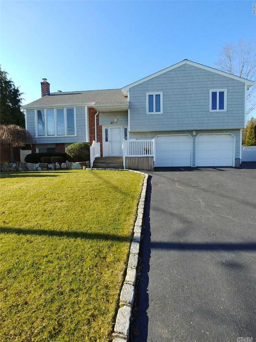 Location Location !! Spacious 4 Bedroom Split With Large Livingroom, Fdr, Den With Fireplace, 2 Car Garage And Fully Fenced In Beautiful Yard With Rear Patio And Upper Deck In Award Winning Commack School District!! Wont Last ! Be The 1st