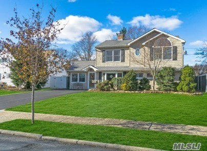 Like New House, Many Updates Thru-Out This Lovely Colonial In Levittown School District. Home Features, 4 Br, 2 Baths, Large Mbr, New Granite Eik W/Ss Appliances, Dual Fireplace In Eik And Fdr, Flr And Separate Den, Laundry Room, New Hwh, 200 Amps Electric, Oversized Yard, Fenced Yard, Covered Patio, Shed, Igs, New Driveway With Paver Boarder, Pull Down Stairs For Attic Storage, Close To Local Park, Super Clean Home, Must See!
