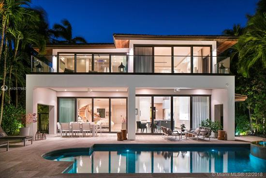 Influenced By The Tropical Design Of Its Surroundings, This Stunning Modern Waterfront Home Offers Breathtaking Bay Views Of Miami Beach Through Telescopic Floor To Ceiling Pocket Sliding Glass Doors. Boasting An Italian Kitchen & Doors, Miele/Subzero Appliances, Dornbracht Bath Fixtures And A Lutron Lighting /Savant Automated Smart System, Enjoy Serenity And Privacy As You Enter The Residence Through A Beautiful Courtyard Surrounded By Trees.