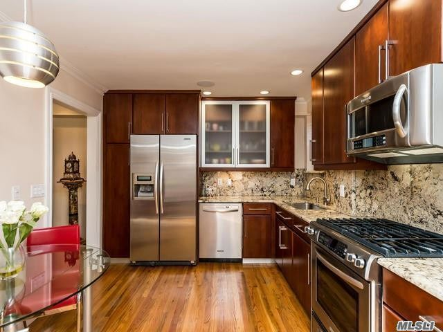 Completely Renovated 1200 Sf Top Floor Co-Op With Terrace & Multiple Exposures. Gracious Layout Includes Large Entry Foyer, Lr, Dr, Eik, Pwdr Rm, Spacious Mbr W/Mbth + 2 Wic, Second En Suite Br + 3rd Br That Can Be Used As Den/Home Office. Lots Of Closets, Hw Floors, Laundry On Each Floor, Garage Parking. Low Maintenance $1, 313.60/Monthly. Close To Lirr, Town And Shops.