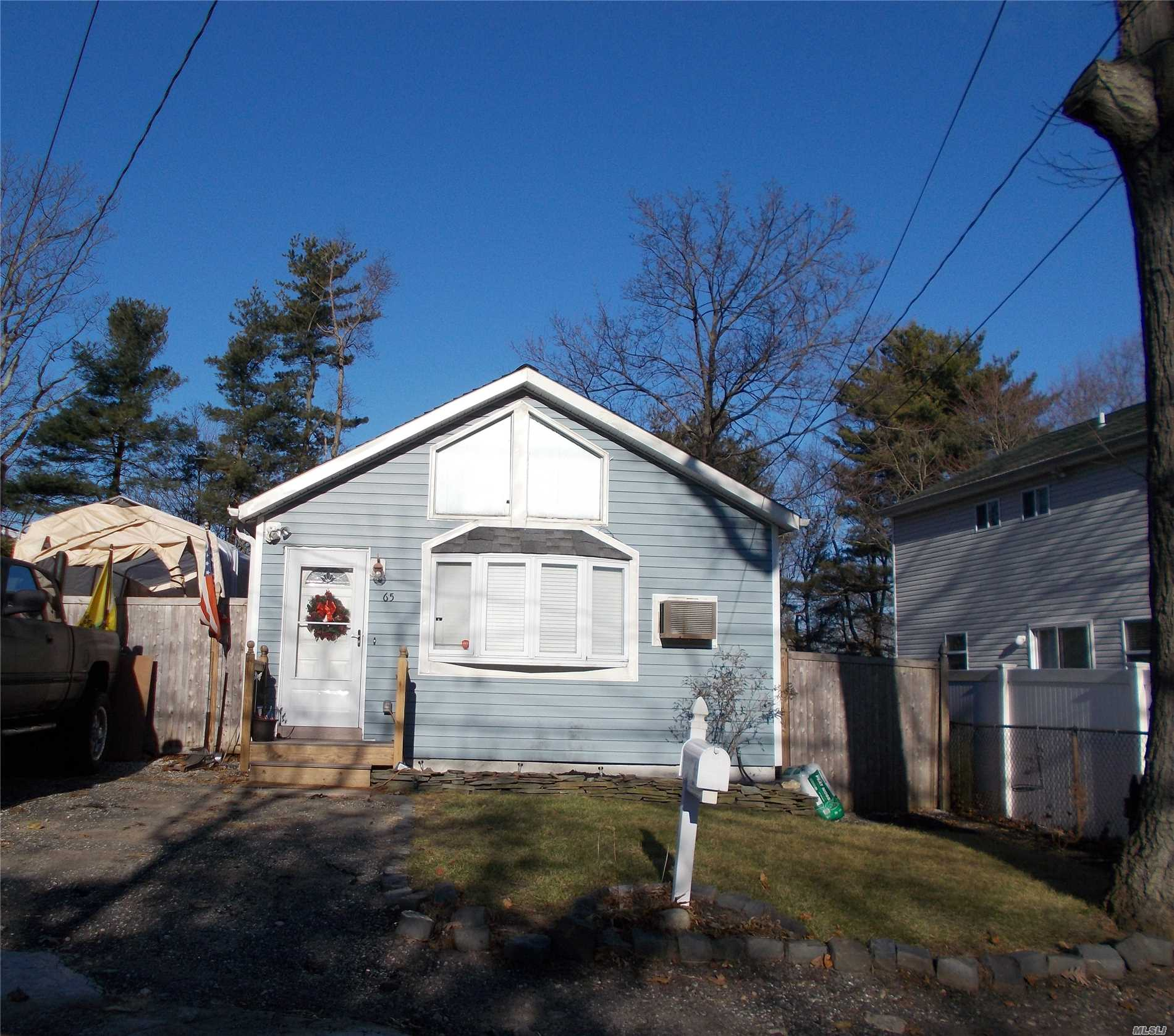 Bright & Airy 2 Bedroom Ranch. Living Room W/Cathedral Ceiling, New Kitchen, Newer Siding, Roof & Windows. Walk To L.I. Sound Beach.