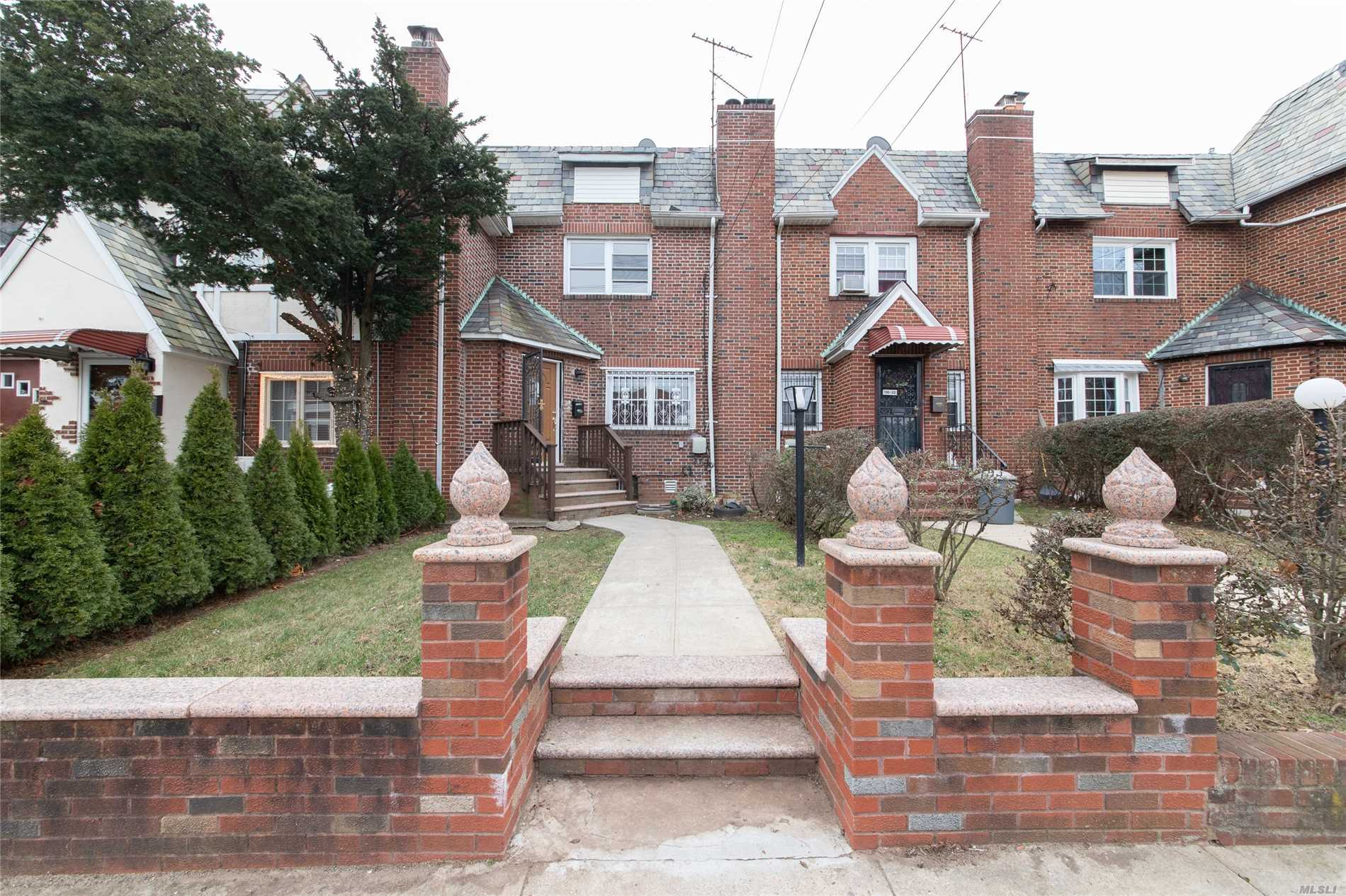 English Brick Tudor In The Heart Of Saint Albans, Queens. Conveniently Located Around The Corner From The (Lirr) Long Island Railroad (St. Albans Stop). Enter Into The Foyer Then Proceed To The Open Floor Plan Livingroom With The Original Parquet Hardwood Flooring And A Brick Fireplace For Those Cozy Evenings. There Is A Half Bath On The First Floor For Guests. The Formal Dining Room Area Leads Into The Open Concept Kitchen With All New White Cabinetry With Soft Closed Cabinets And Drawers...