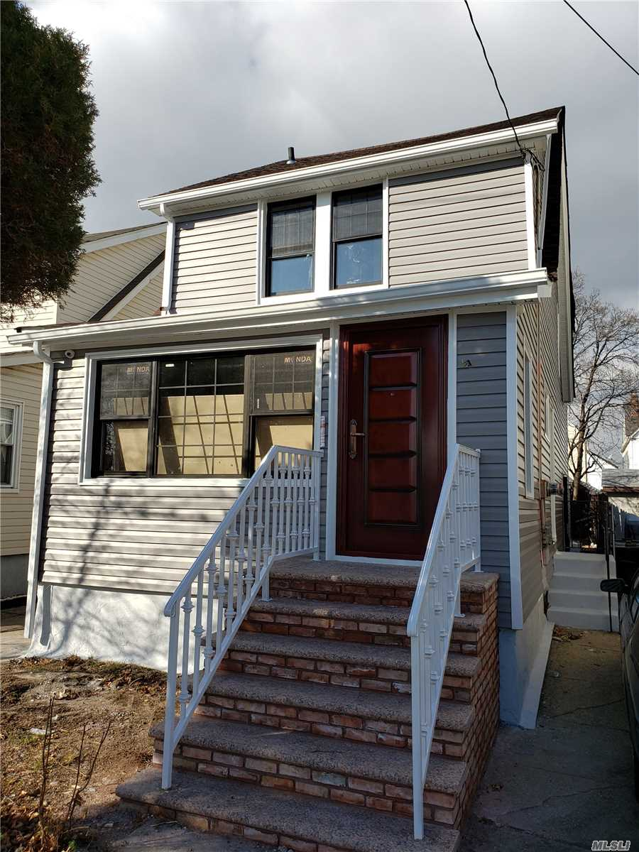 Fully Renovated Brand New 2 Family. 5 Beds 3 Baths. Full Walk-In Basement. Private Driveway Wood Floors Throughout.