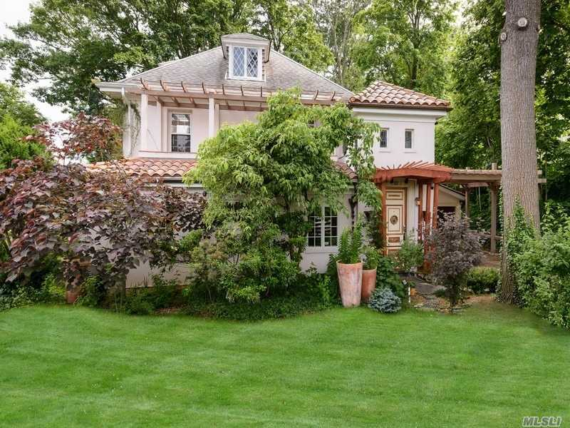 A Magnificent Colonial With A Mediterranean Flare. Impressive 20 Ft Entry With Custom Woodwork, Gourmet Chef's Kitchen With Ss Appliances, Granite Counter Tops And Gleaming Hardwood Floors. Radiant Heat In Kitchen, Den And Hall. Attention To Detail Prevails In This Wonderful Residence.  A Chic New York City Feel In Oyster Bay!