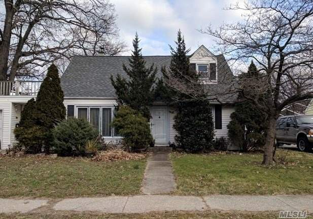 Cape Style Home On Dead End Street. Situated On A Nice Sized Lot Is Being Sold Occupied. Great Investment Opportunity For The Right Buyer!