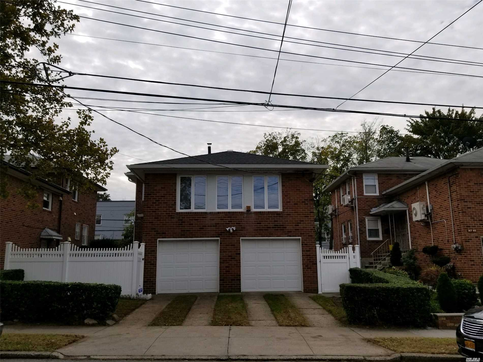 Rare Find In The Heart Of Flushing. Close To All Transportation And Shopping.Unique 2 Family Solid Brick 2 Family Split Duplex. 1st Flr Is A Duplex W/Lg. Eat In Kitchen On The First Level And 2nd Level Has A Full Bath, Bedroom And Living Rm. Owners Apartment Has 3 Bedrooms, 2 Full Baths, Formal Dining Rm., Lg Eat In Kitchen..Fully Functional Basement W Sep. Ent.