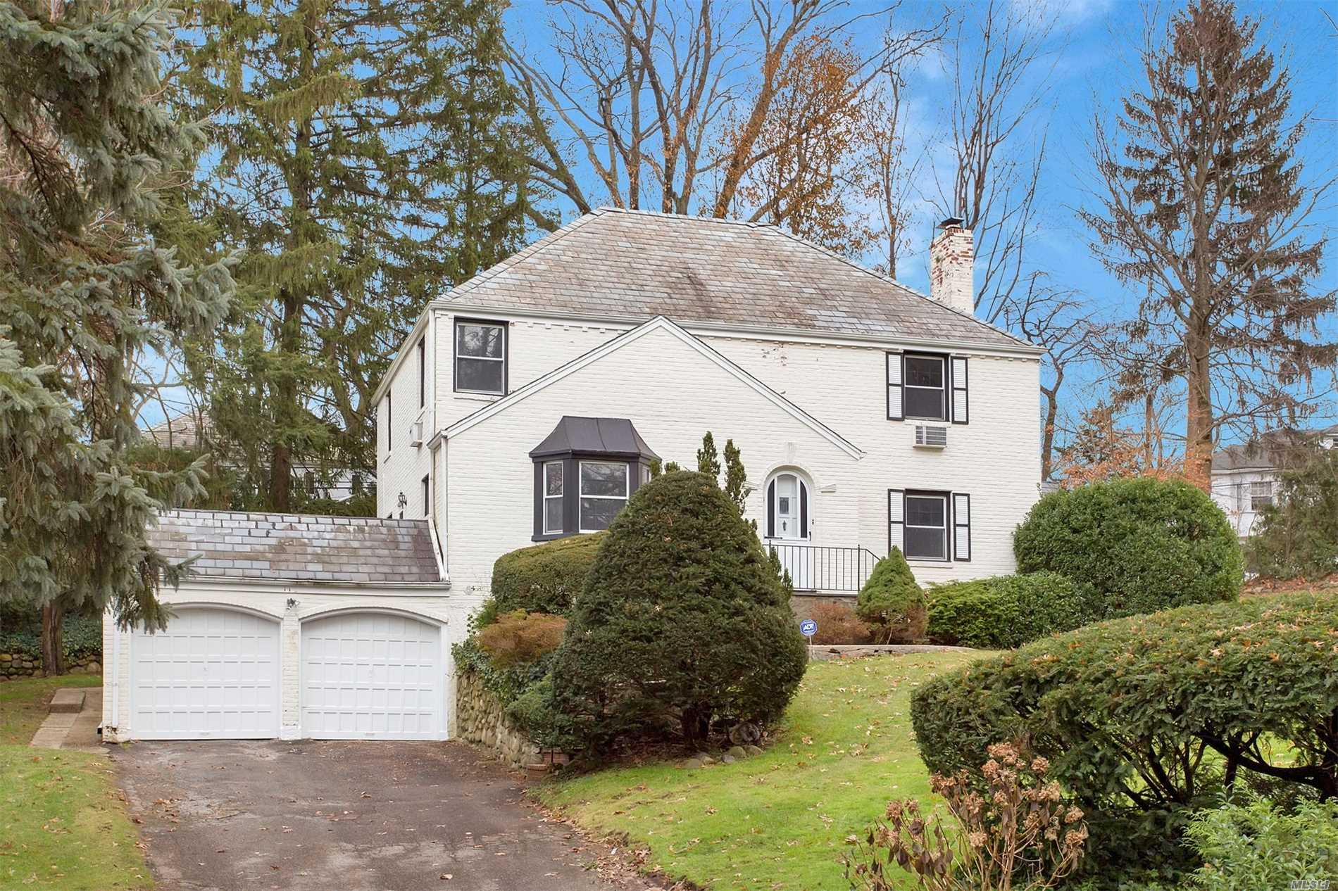 Fabulous Strathmore Vanderbilt Location. Brick Center Hall 4 Bedroom Colonial With Large Foyer With Curved Staircase. Living Room With Fireplace. Large Formal Rooms, Gas Cooking. Low Taxes. House Being Sold As Is.