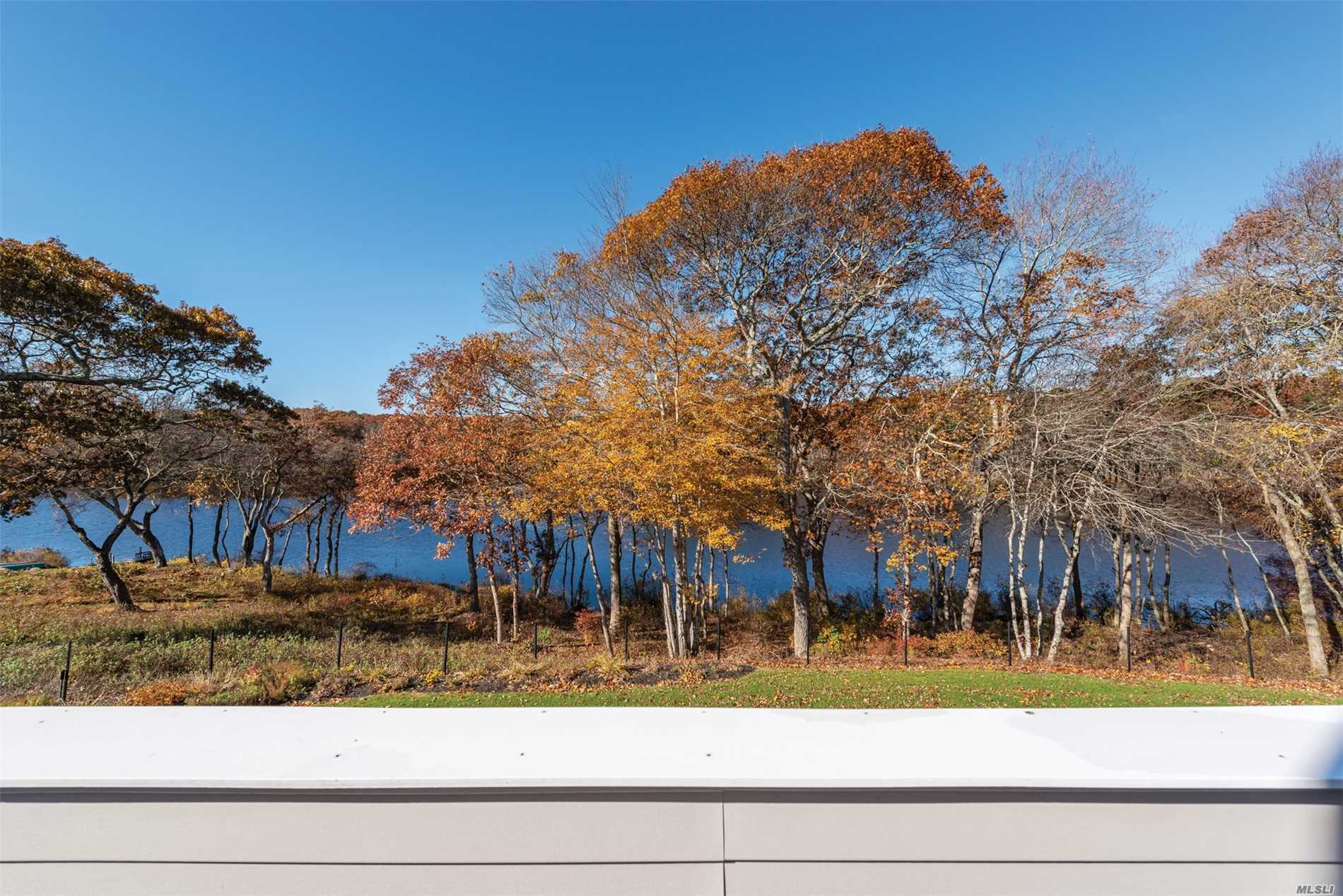 Custom 2 Br Condo In The Lakefront Community Of Beaver Lake. Custom Kitchen, Custom Mouldings Near-End Unit Very Private With Gorgeous West Lake View. Amazing Sunsets. Community Pool. Upper And Lower Decking, Sky Lights, Beach Rights, Short Distance To The Village Of Westhampton Beach.