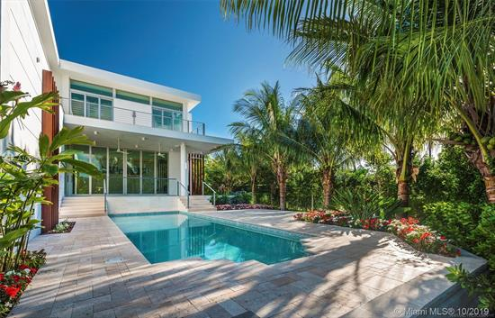 A Contemporary Two Story Elegant Designed Home Built In 2018 With Airy Open Spaces. House Features 12 Ft Glass Doors And Celings Thru-Out Entire House. Enjoy Lots Of Light And The Feeling Of Nature Surrounding You. Large Covered Terrace Opens Unto Pool And Manicured Serene Tropical Garden. A 5 Br, 5.5 Bath. Enjoy: Dumb Waiter, Elevator, Two Dishwashers, Huge Master Br And Closet And Many Hi-End Custom Finishes. Oversize Corner Lot, Size 9, 884 Sq.Ft. With Lots Of Parking. Total Sq. Ft Area 6, 866 Sq.Ft.