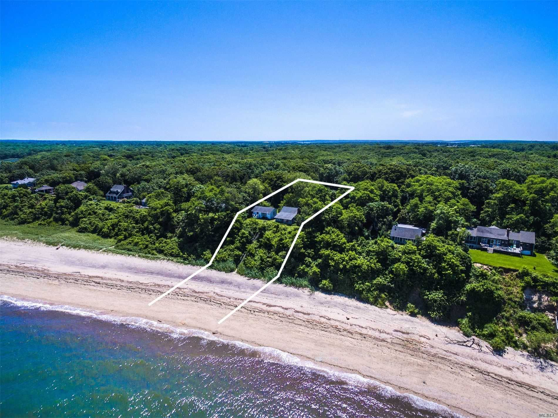 Tranquil & Private. Nestled Atop This Well Protected Sound Front Property Rests This Quintessential North Fork Residence & Guest Cottage. Enjoy Expansive 180 Degree Views Of The Li Sound & Private Beach Access, W/ Native Vegetation & Protected Peconic Land Trust Land To The South Of The Property. Main House Offers Newly Renovated Open Living W/ 2 Beds & 1 Full Bath, While The Guest Cottage Offers A Studio Type Set Up W/ Newly Renovated Full Bath. The Perfect Location To Escape From It All!