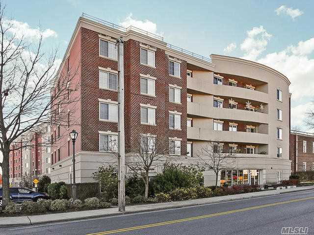 Great 1 Bedroom Doorman Luxurious Building. Hardwood Floors, New Kitchen, Living Room With Fireplace Dining Room, Large One Bedroom, Laundry In Unit, 1.5 Baths, Central Air A Must See !!! Corner Unit, Quiet Building, Garage Spot For Parking  Amenities Include Gym, Library, Card Room, Party Room, Heated Pool / A Must See !!!