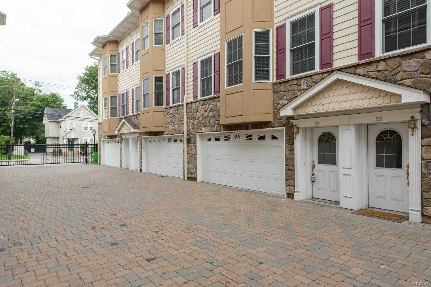 9 Year Young Gorgeous Townhouse Features 2 Bedrooms, 2 Bathrooms, 2 Car Garage, Large Living Room /Dining Room, Eat-In-Kitchen, All Open Floor Plan, 2 Large Bedroom With Vaulted Ceilings, Upgrades Throughout, Central Air, Gas Heat, Gated Community A Must See !!!!  Don't Miss This Opportunity !!
