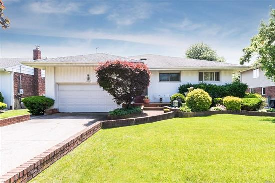 Beautiful Raised Ranch In The Heart Of N. Woodmere. Close To All! 4 Bedrooms, 2 Full Bathrooms (Formally 3 Bths Was Converted To 2 Can Be Converted Back To 3), Large L-Shape Kitchen With Dinette And Big Formal Dining Room. Lower Floor Has A Wet Bar And Wood Burning Fire Place.