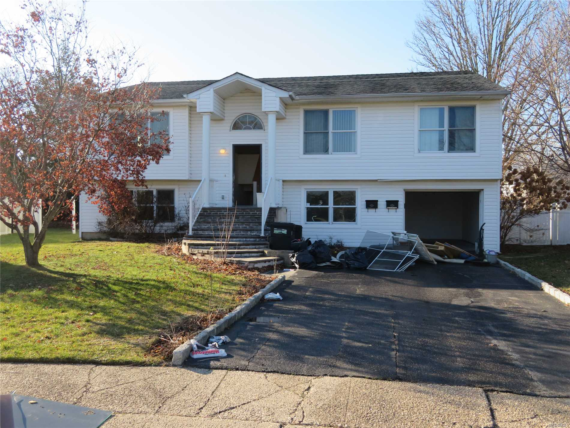Bank Owned Foreclosure. Large Hi Ranch Located In A Desirable Cul-De-Sac. Perfect For Large Or Extended Family. Open Floor Plan, Large Rooms, High Ceilings.