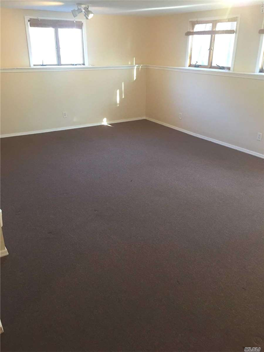 Large Studio Apartment, Plenty Of Natural Light. Efficient Kitchen, Large Hallway Leading To Bathroom. Hallway Can Be Utilized As An Office Area. Private Entrance And Driveway Parking.
