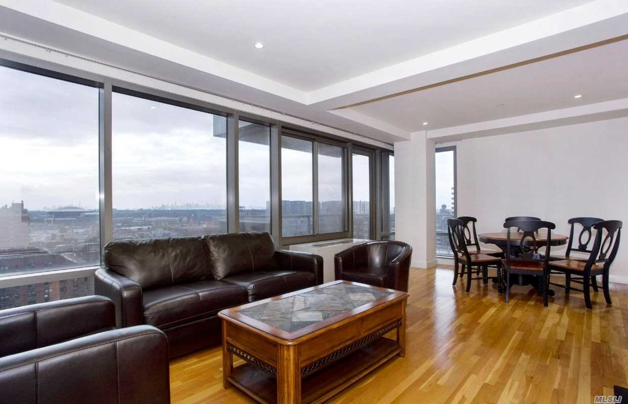 Arcadia Is Located In The Heart Of Flushing. This Stunning Home Features 3 Bedrooms, 2 Full Baths, 2 Balconies, Washer And Dryer In The Unit. Building Is Impeccable Maintained With 24 Hr Doorman. The Modern Kitchen Is Equipped With Stainless Steel Appliances. An Exquisite Corner Unit With A Breathtaking Panoramic View Of Manhattan Skyline. Conveniently Located To Lirr, Subway, Supermarkets And Restaurants. *1, 428 Gross Sq. Ft/ 1, 097 Net Sq. Ft*
