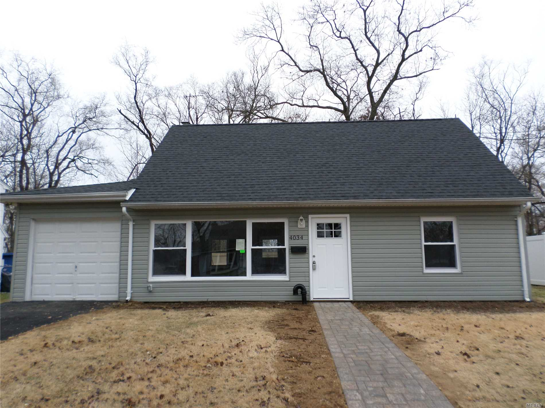 4 Bedrooms, 2 Full Baths, Open Concept. Completely Re-Done! Roof Is Brand New As Well As Windows And All Of The Interior Finishes. Siding 8 Yrs Old. Beauty! First Floor Radiant Heat Throughout. Won't Last!