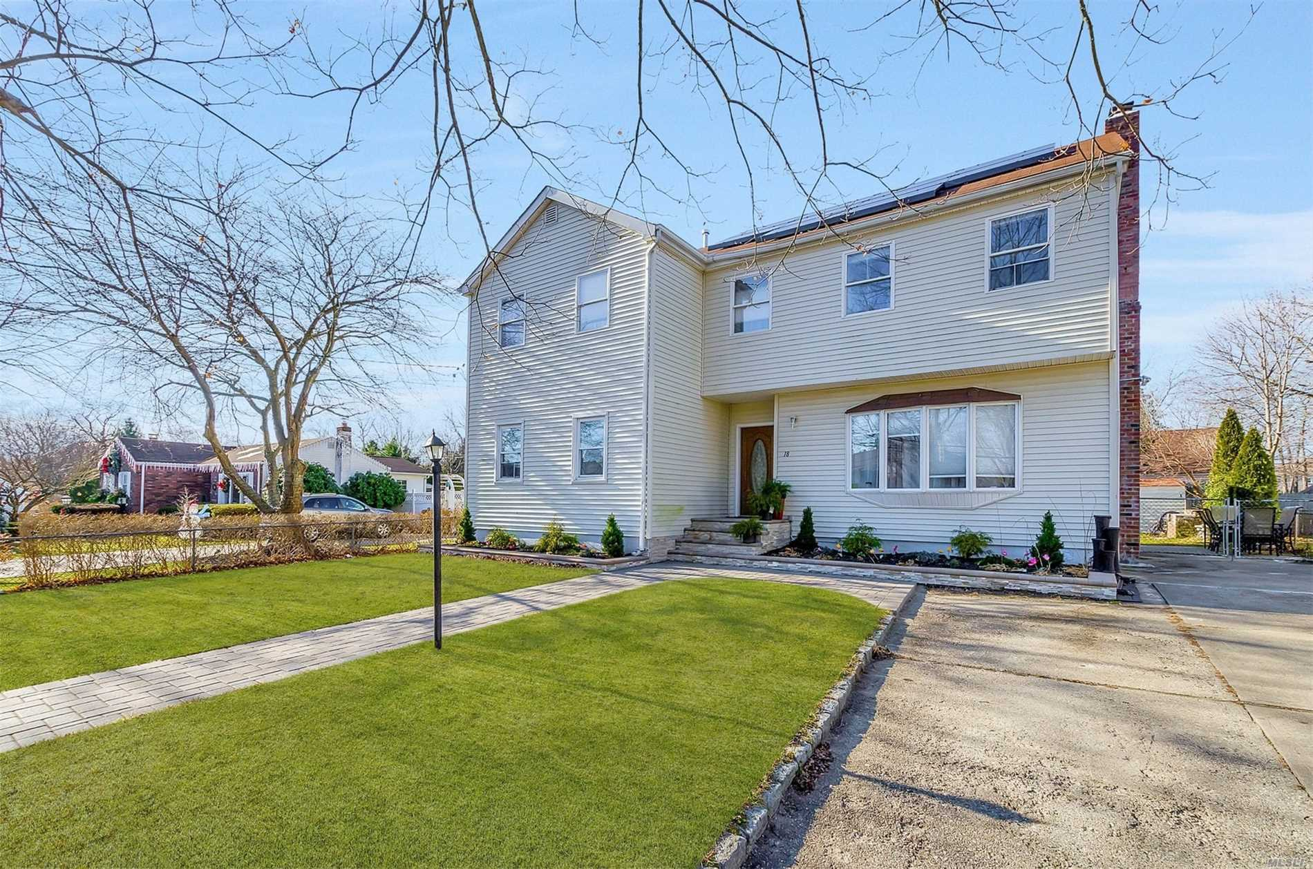Magnificent Over-Sized 6 Bdrm Colonial Updated Roof Windows & Siding Custom Pavers Walkway & Front Steps Large Cement Driveway W/Cobble Stone Border Open Flr Plan Hrdwd Flrs & Recessed Lighting Throughout Beautiful Fire Place Updated Kit With Granite Counter Tops Ss Apli Lots Of Cabinet & Counter Space Breakfast Bar Custom Tile Backslash Large Bdrms 2 Updated Bths Full Basement W/High Ceilings Gas Heat