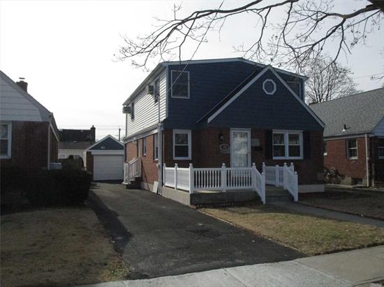 Nicely Renovated Expanded Fully Dormered Cape With Brand New Granite Kitchen, Brand New Bathrooms, New Roof, New Wood Floors. Full Finished Basement And 1 Car Detached Garage