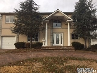 Large Center Hall Colonial With Circular Driveway In Plainview-Old Bethpage Schools. Includes 4 Bedrooms, 3 1/2 Baths, And Large Finished Basement.