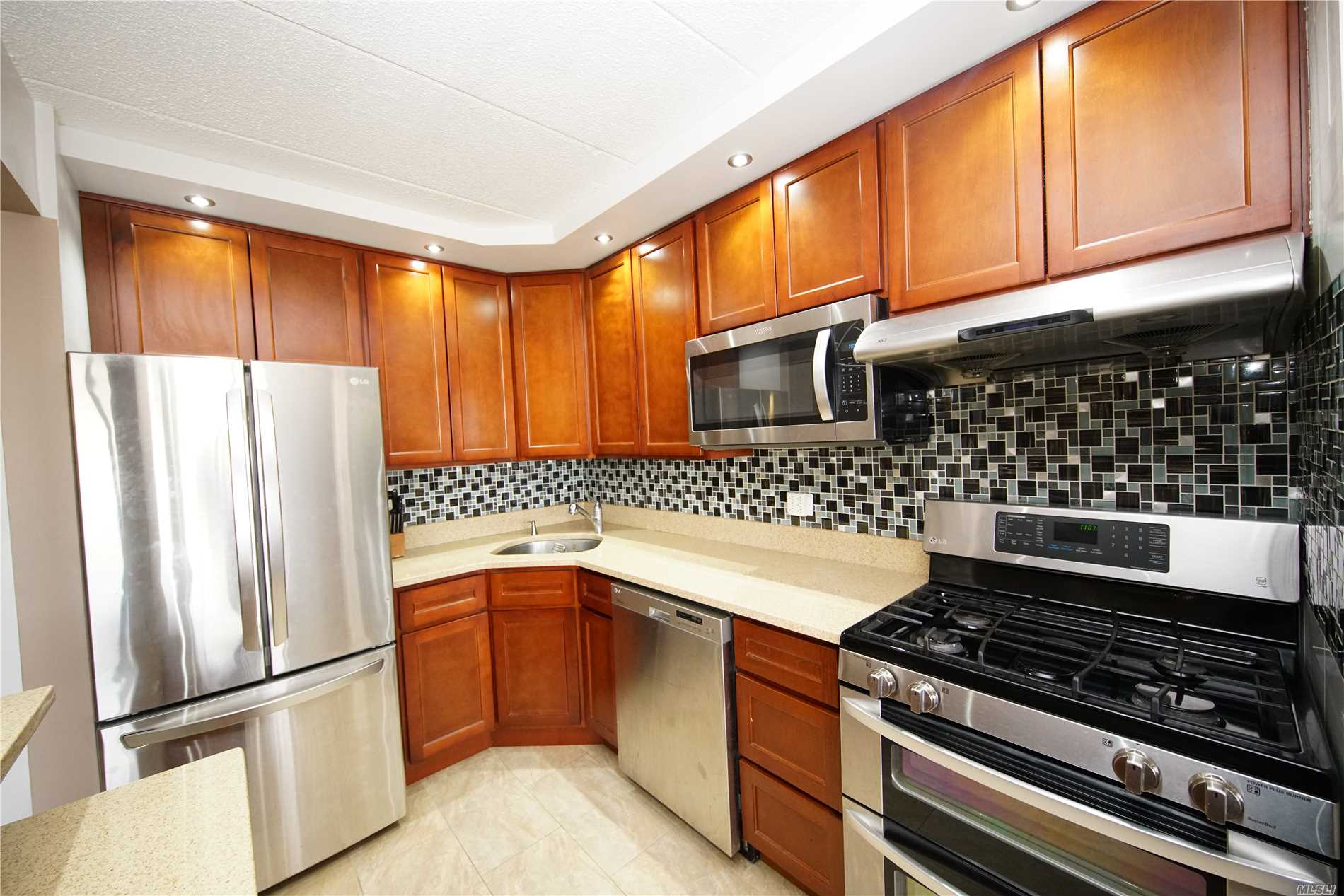 Luxury Two Bedroom With 1.5 Bath Including 1 Parking Space, Nice Balcony. Common Charge Include Gas, Heat Hot Water. Located On 12 Fl, Walking Distant To Train Station, Queens Mall, Costco And Restaurants, Etc. 24 Hour Door Man.
