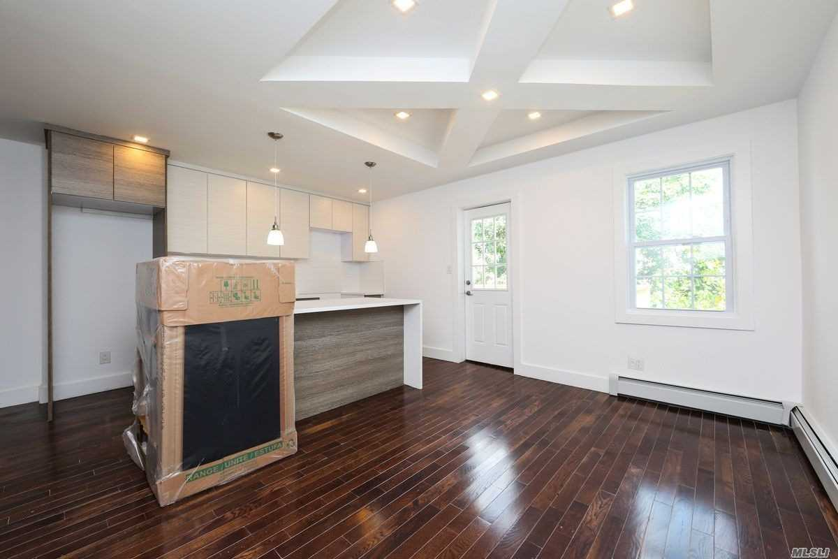 Beautiful Newly Renovated Apartment Featuring Granite Countertop, Stainless Steel Appliances, Lots Of Cabinets,  Island With Bar Stool Seating. Hardwood Flooring & Recessed Lighting Throughout! Outdoor Space! Located Close To Major Transportation, Schools, Shopping Centers & Highways.