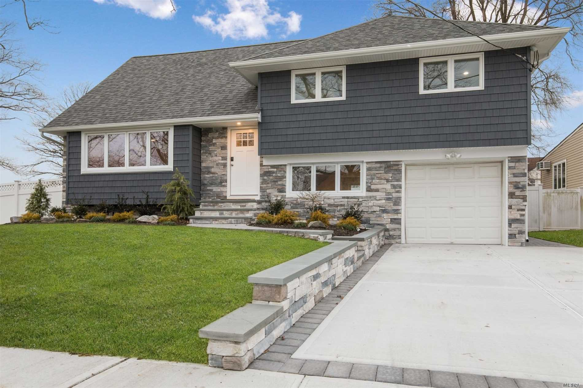 Diamond Condition 3/4 Bedroom Expanded Split On A 79 X 100 Lot. Home Features:Living Rm/Dining Rm W/Open Layout Concept, Hardwood Flrs, Quartz Kitchen & Island W/Stainless Steel Apps, 5 Ductless Air Conditioners & Sliders Leading To Rear Trex Deck.2nd Floor Has Bedroom With Walk-In Closet, Bedroom & Full Bath. Master Bedroom Suite W/Full Bath & Closets. Laundry Room, Garage, 200 Amp Electric, Pvc Fencing, In-Ground Sprinklers, New Siding W/Cultured Stone Brick Face, 2 Car Driveway & Low Taxes !