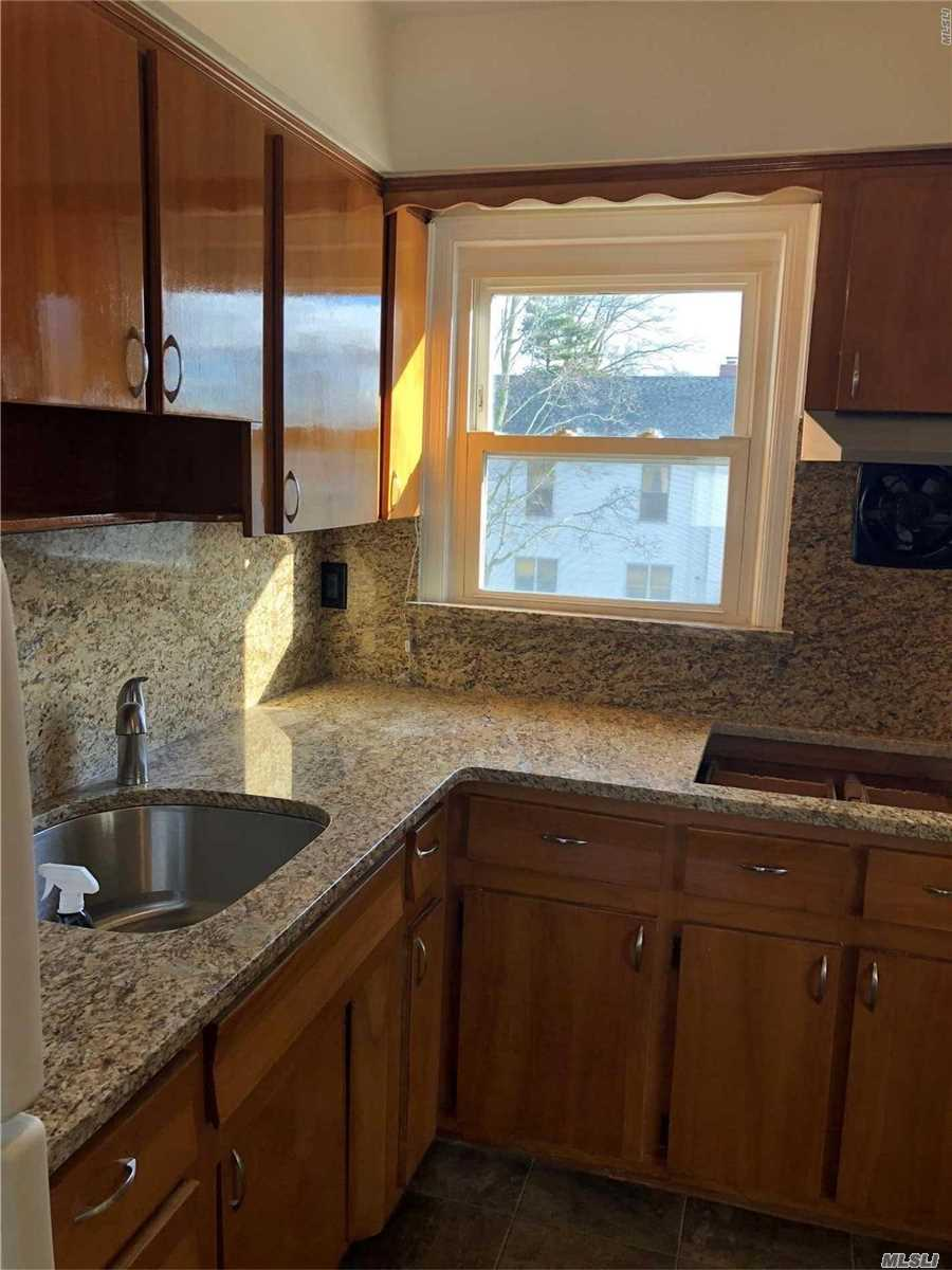 Spacious 2 Bedroom 2nd Floor Rental. New Carpeting Throughout Apt. Kitchen Has New Granite Countertop And Backsplash, New Stovetop And Wall Oven. Bathroom Has Been Newly Renovated. Corner Property With 2 Parking Spaces.