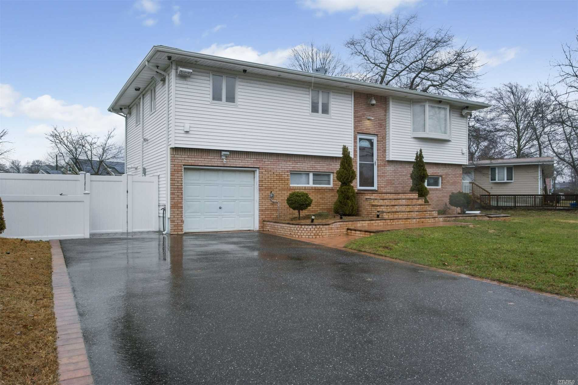 Mint Hi-Ranch, Skylite Entry Foyer. Open And Airy Living Room, Dining Room And Kitchen. All Updated Including Kitchen, Roof, Windows,  Gas Heating System, Gas Cooking. Ductless A/C. Alarm. Ceramic Tiled And Wood Floors.. Pvc Fencing. Entertainers Backyard W/2 Level Decking On Oversized Deep Property...