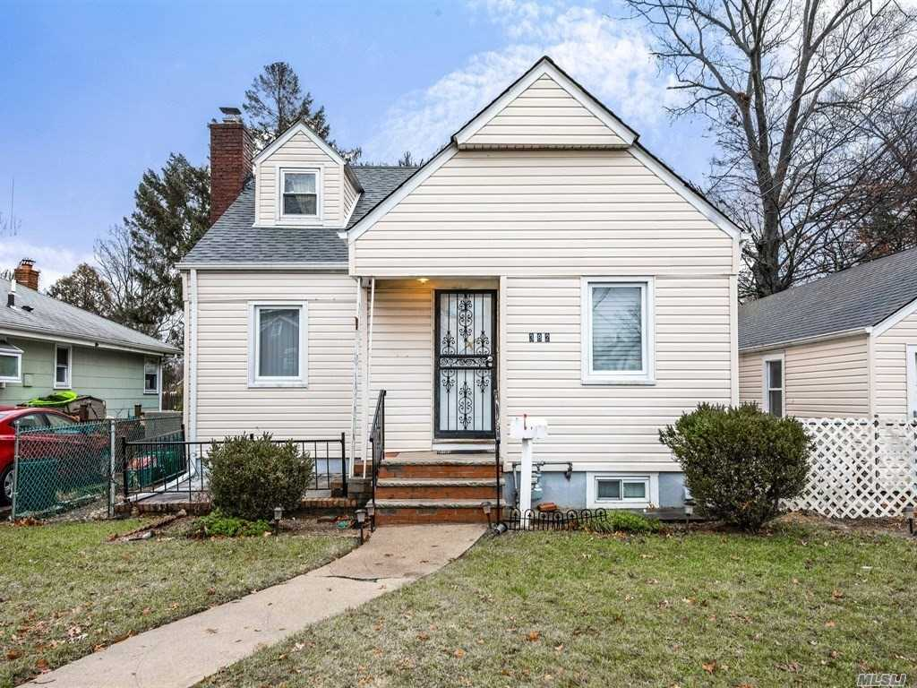 Spacious And Move In Ready Cape Home On Large Property With 4 Car Detached Garage!! Eat In Kitchen Has Nice Separate Dining Area, Living Room With Hardwood Floors, 2 Bedrooms On Main Floor, Full Bath. Upstairs Has A Large Bedroom And Office / Den Area. Possible 4th Bedroom. Full Finished Basement