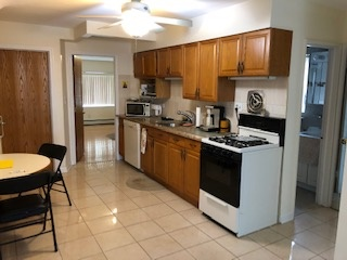 ID# (NIC) Beautiful Legal 2 Family Home In Bayside.  Excellent Condition, 2 Bedrooms Over 1, Split Unit, 2 Full Baths, Living Room, Formal Dining Room, Sliding Doors To Yard And A/C. In School District 26, Close To All.. A Must See!! 	 For more information please contact one of the Carollo Realty's locations Whitestone (718) 747-7747, Flushing (718) 224-9083, Glendale (718) 366-6636 or visit our website at www.CarolloRentals.com   Why Go Anywhere Else?