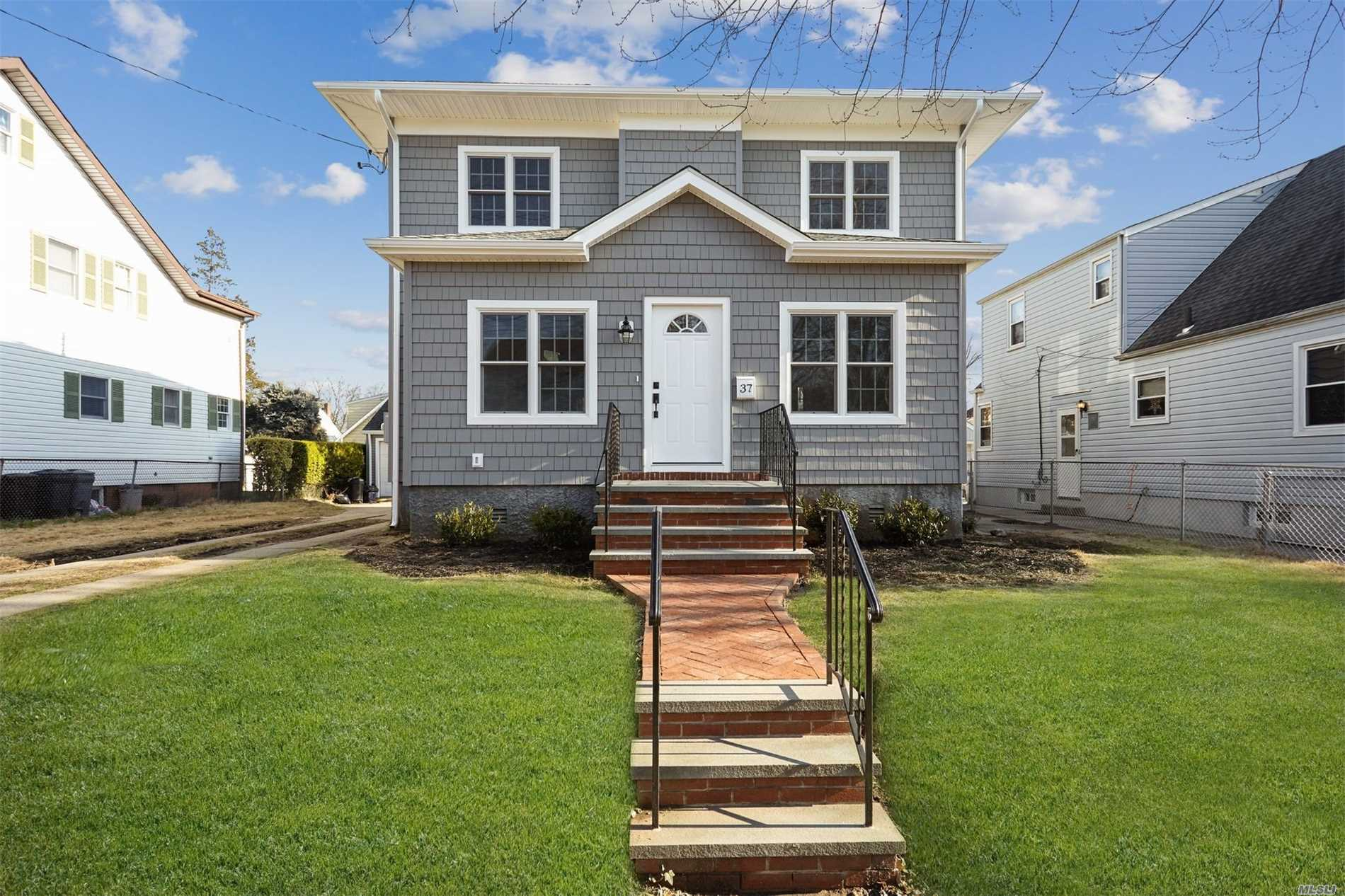 New To The Market!! Completely Renovated/Expanded Colonial, 4 Bedrooms & 2.5 Baths On Spacious 60X100 Lot. All New Electric(200 Amp), Plumbing, Heating/Central Air Conditioning, Andersen Windows, Kitchen Features Large Granite Island, Stainless Steel Appliances, Oak Hardwood Floors Throughout, 9 Ft Ceilings, High Hat Led Lighting, 2 Car Garage Great For Work Room/Storage. Exterior Features Large Property With Rear Patio W/Pavers. All New Roof/Siding, New Sheetrock And Insulation.