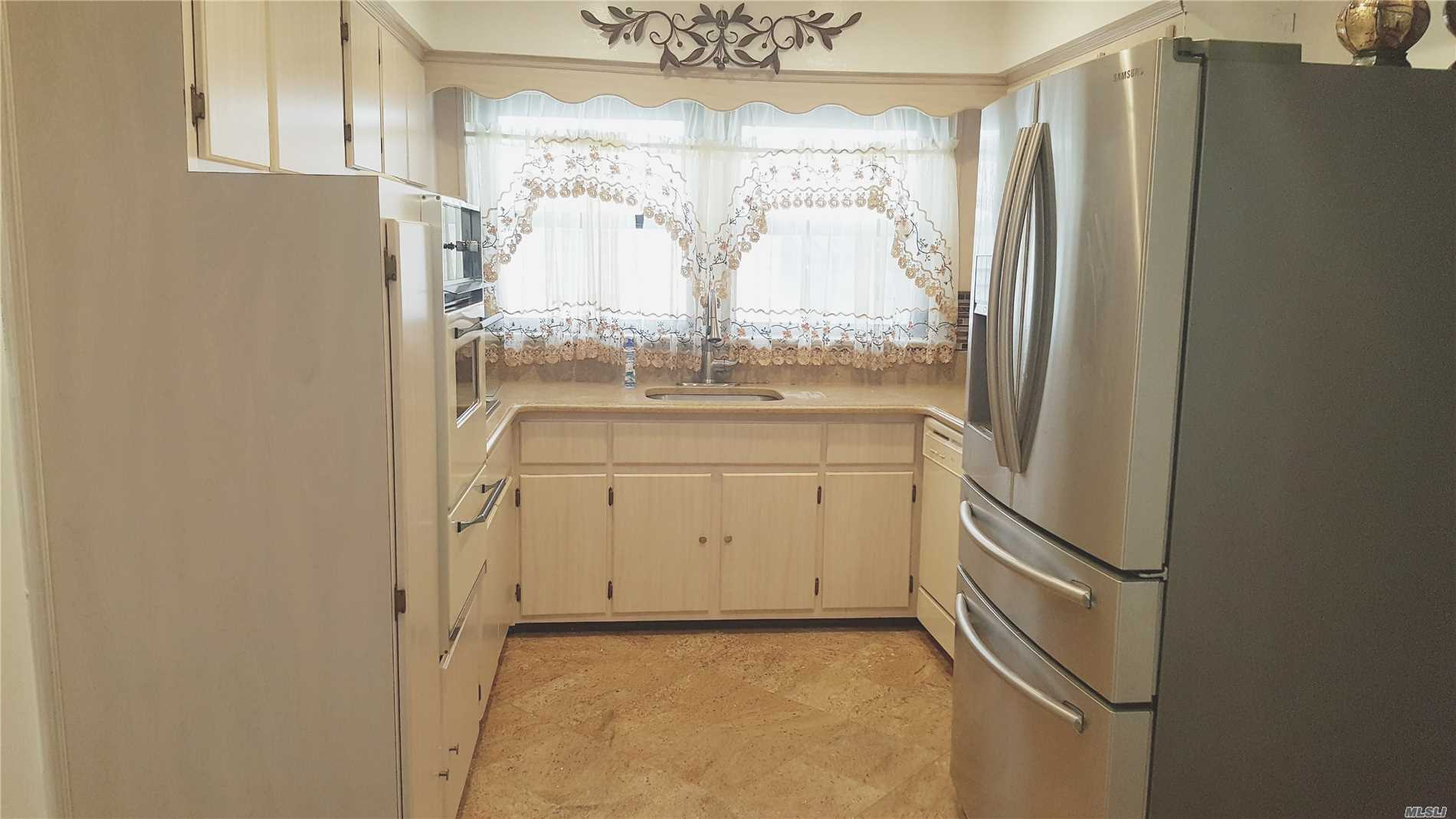 2 Family House. Apt On The First Fl. 1/2 Basement Laundry Room Included For Additional Rent. Newly Renovated Bath With Jacuzzi Tub. Brand New Samsung Refrigerator. Wood Floors.