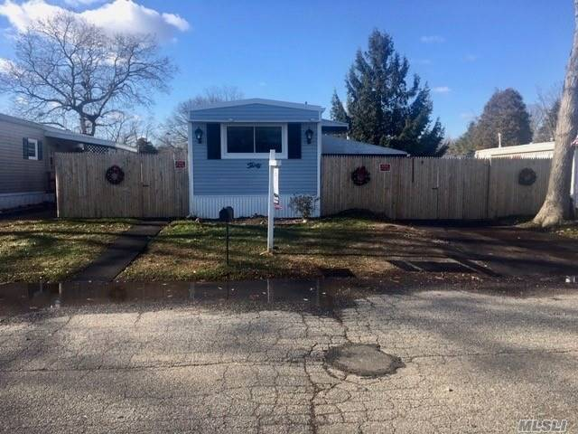 Lovely Mobile Home In Bunker Valley With Many New Updates, Including: Roof, Siding, Insulation, Windows, Floors, Driveway, Door, Hot Water Heater, Toilet, Bathroom Sink. New Appliances <6 Months Old. Fully Insulated Underneath Including Pipes Which Is Essential To Holding Heat And Ac Temps! Brand New Fully Enclosed Fence, Perfect For A Dog Owner...2 Sheds, Plus An Enclosed Florida Rm W/Wood Burning Fireplace!  Home Also Has A New Security/Camera System. Close To Shopping And Transportation.